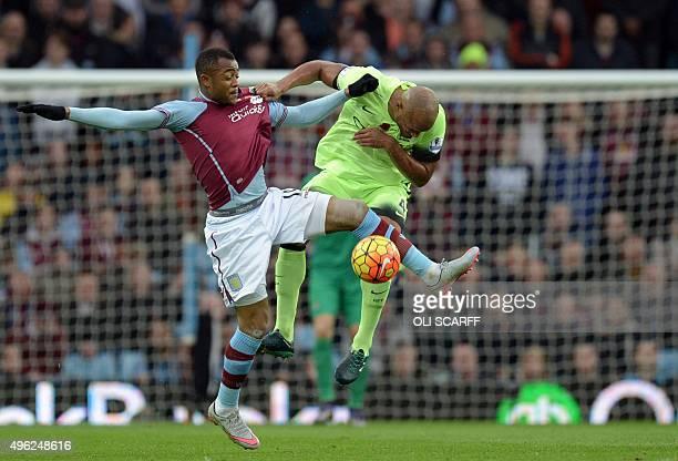 Aston Villa's Ghanian striker Jordan Ayew vies with Manchester City's Belgian defender Vincent Kompany during the English Premier League football...