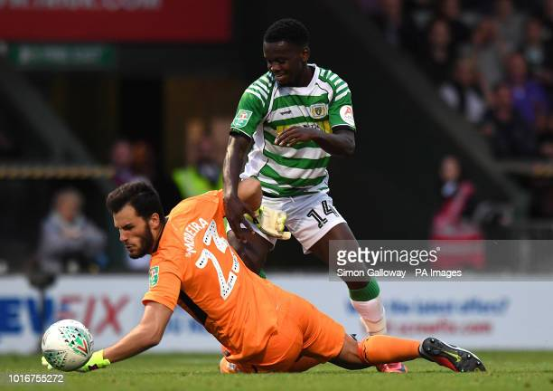 Aston Villa's Goalkeeper Andre Moreira and Yeovil Town's Diallang Jaiyesimi during the Carabao Cup First Round match at Huish Park Yeovil