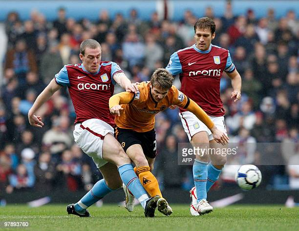 Aston Villa's Irish defender Richard Dunne vies with Wolverhampton Wanderers' Irish striker Kevin Doyle during the English Premier League football...