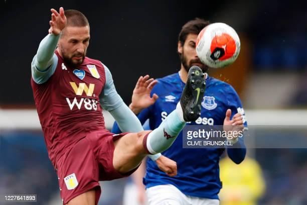 Aston Villa's Irish midfielder Conor Hourihane vies with Everton's Portuguese midfielder André Gomes during the English Premier League football match...
