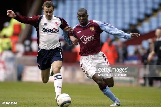 Aston Villa's J Lloyd Samuel and Middlesbrough's Szilard Nemeth battle for the ball