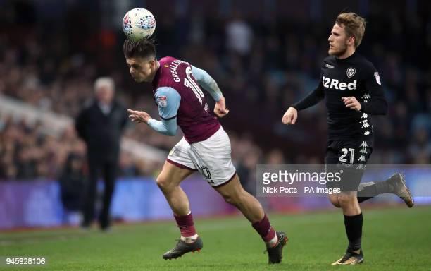 Aston Villa's Jack Grealish and Leeds United's Samuel Saiz battle for the ball during the Sky Bet Championship match at Villa Park Birmingham