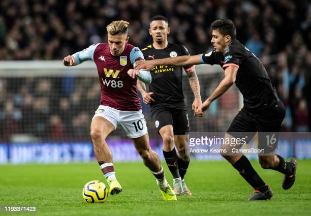 Aston Villa's Jack Grealish competing with Manchester City's Rodri during the Premier League match between Aston Villa and Manchester City at Villa...