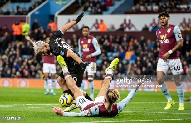 Aston Villa's Jack Grealish competing with Manchester City's Sergio Agüero during the Premier League match between Aston Villa and Manchester City at...