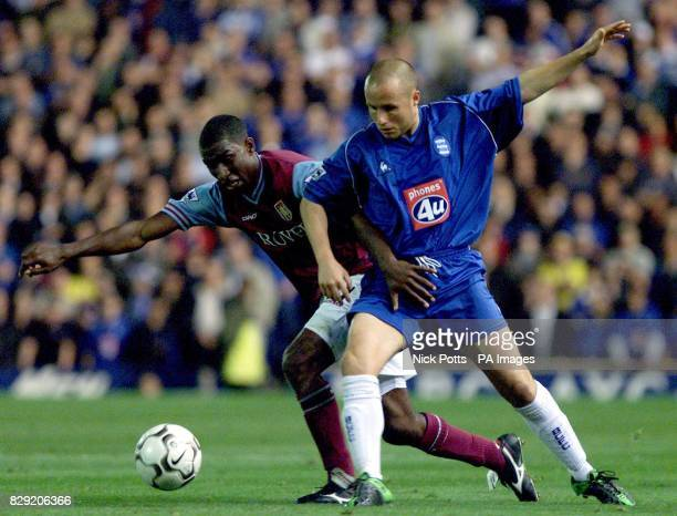 Aston Villa's JLloyd Samuel tussles with Birmingham City's Paul Devlin during the Barclaycard Premiership match at St Andrews Birmingham THIS PICTURE...