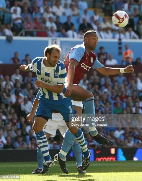 Aston Villa's John Carew and Odense BK's A Haland battle for the ball