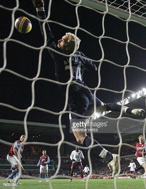Aston Villa's John Carew watches his header beat Arsenal's goalkeeper Manuel Almunia only to hit the cross bar during the Premier league football...
