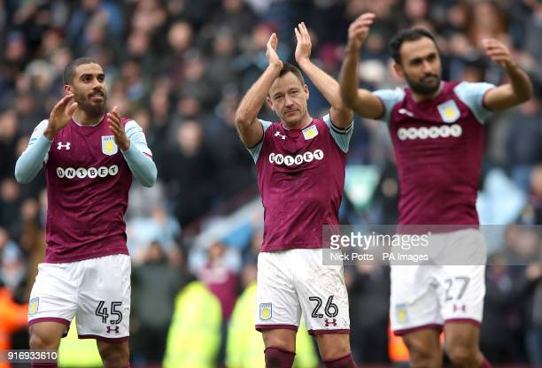Aston Villa's John Terry Lewis Grabban and Ahmed Elmohamady applaud the fans after Aston Villa win 2 0 during the Sky Bet Championship match at Villa...