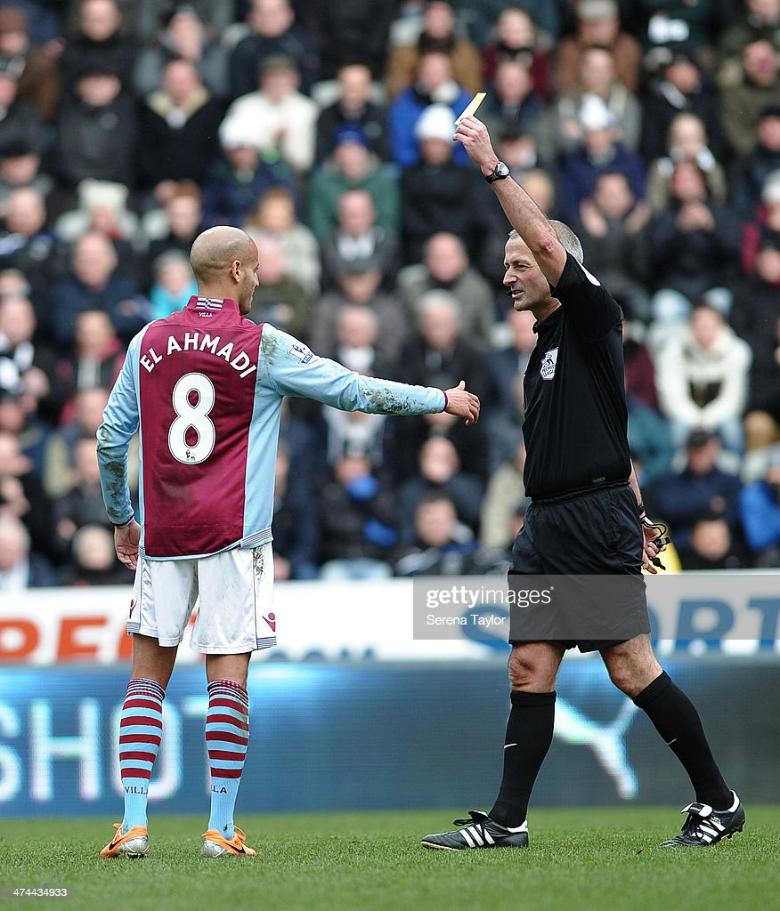Aston Villa's Karim El Ahmadi receives a yellow card from Referee Martin Atkinson during the Barclays Premier League match between Newcastle United and Aston Villa at St. James' Park on February 23, 2014, in Newcastle upon Tyne, England.