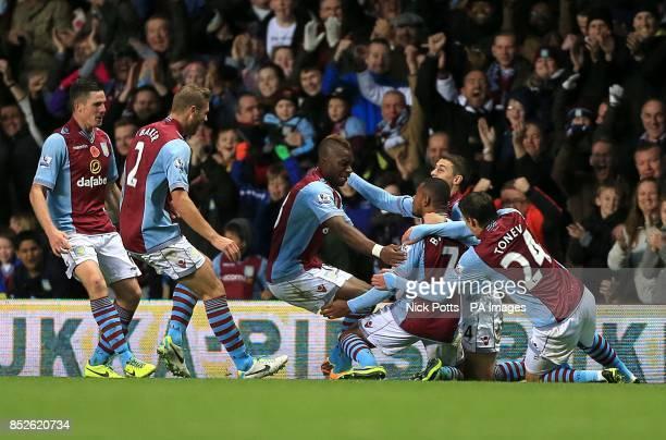 Aston Villa's Leandro Bacuna celebrates scoring their first goal of the game with teammates
