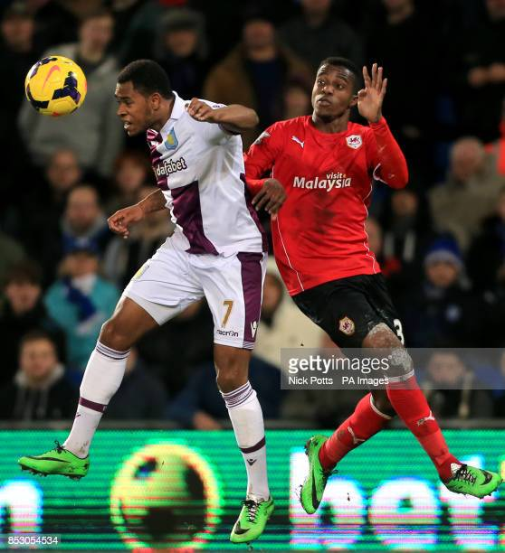 Aston Villa's Leandro Bacuna holds off a challenge from Cardiff City's Wilfried Zaha