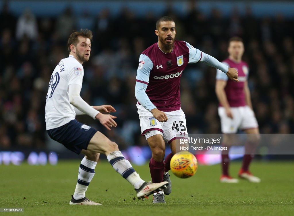 Aston Villa's Lewis Grabban (right) and Preston North End's Tom Barkhuizen battle for the ball during the Sky Bet Championship match at Villa Park, Birmingham.
