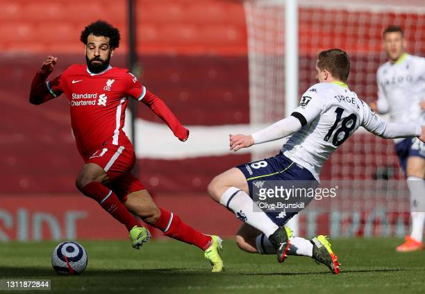 Aston Villa's Matt Targett vies with Liverpool's Mohamed Salah during the Premier League match between Liverpool and Aston Villa at Anfield on April...