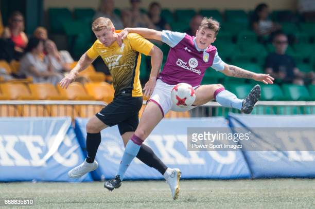 Aston Villa's Mitch Clark competes with Singapore Cricket Club's Ross Plain during their Main Tournament match part of the HKFC Citi Soccer Sevens...
