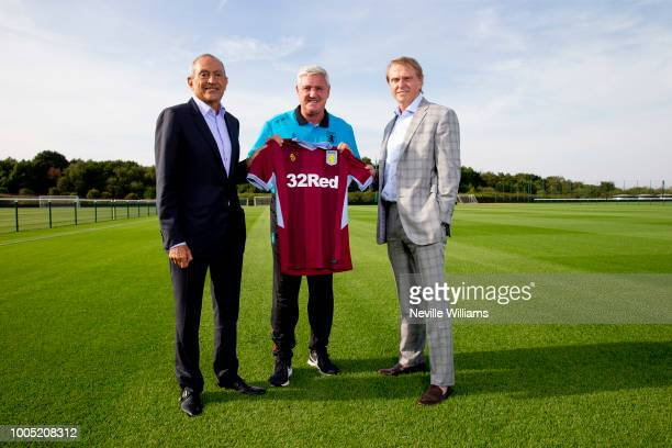 Aston Villa's new investors Nassef Sawiris and Wes Edens pose for a picture with Aston Villa manager Steve Bruce at the Recon Training Complex on...