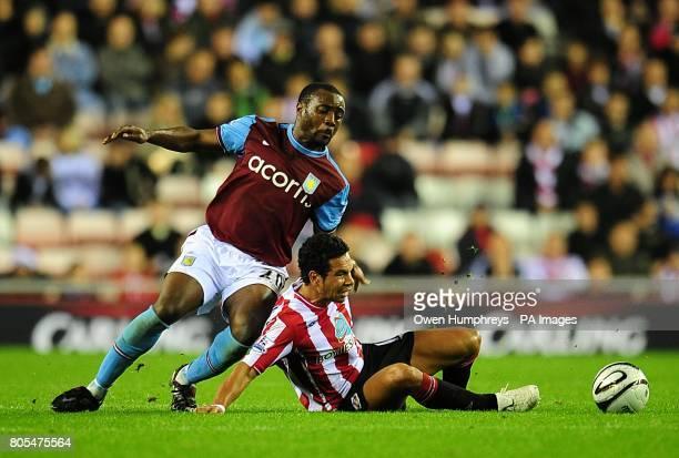 Aston Villa's Nigel ReoCoker and Sunderland's Kieran Richardson battle for the ball