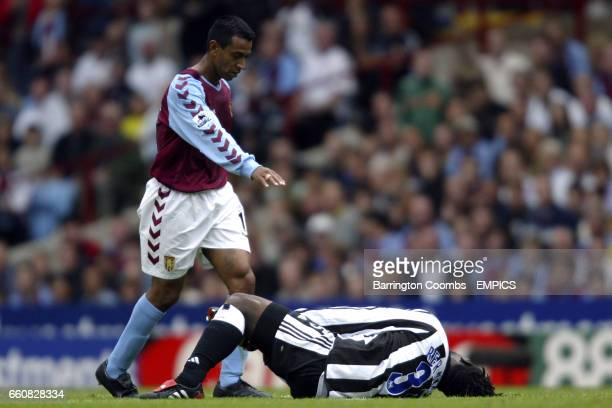 Aston Villa's Nolberto Solano apologises for a late tackle on former teammate Newcastle United's Olivier Bernard