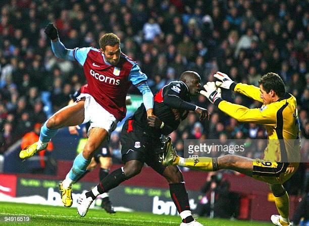 Aston Villa's Norwegian striker John Carew scores the only goal past Stoke's Danish goalkeeper Thomas Sorensen during the English Premier League...