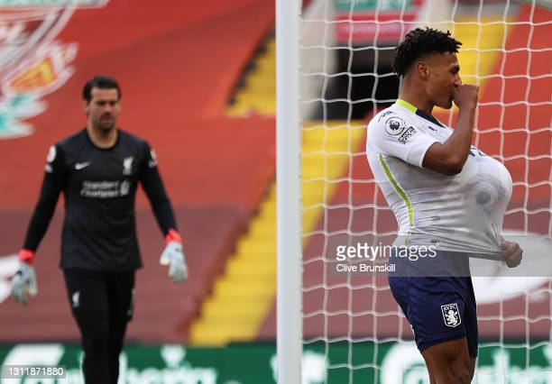 Aston Villa's Ollie Watkins celebrates after scoring the opening goal during the Premier League match between Liverpool and Aston Villa at Anfield on...