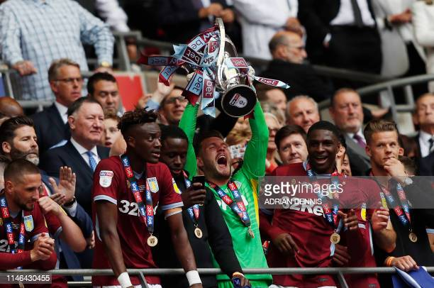 Aston Villa's players celebrate with the trophy after the English Championship play-off final football match between Aston Villa and Derby County at...