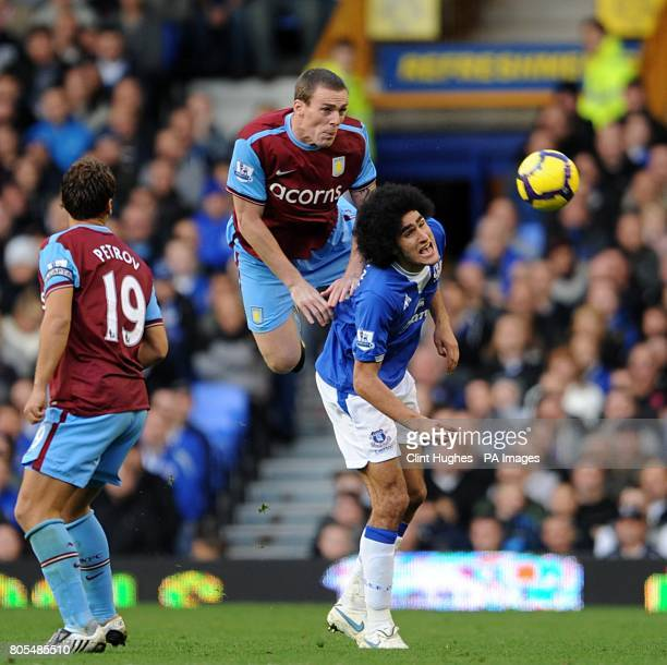Aston Villa's Richard Dunne and Everton's Marouane Fellaini battle for the ball