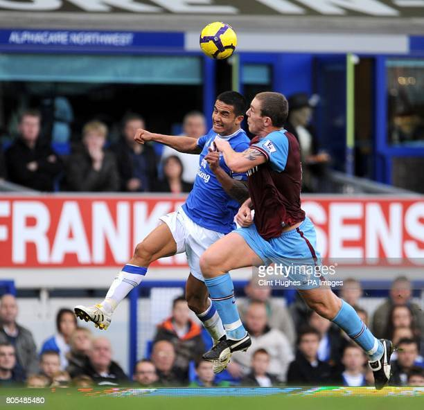 Aston Villa's Richard Dunne and Everton's Tim Cahill battle for the ball