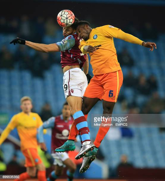 Aston Villa's Rudy Gestede and Wycombe Wanderers' Aaron Pierre battle for the ball in the air