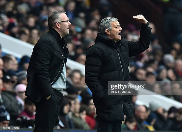Aston Villa's Scottish manager Paul Lambert and Chelsea's Portuguese manager Jose Mourinho watch from the touchline during the English Premier League...