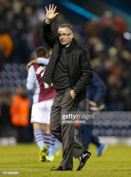 Aston Villa's Scottish manager Paul Lambert waves to acknowledge the crowd at the end of the English Premier League football match between West...