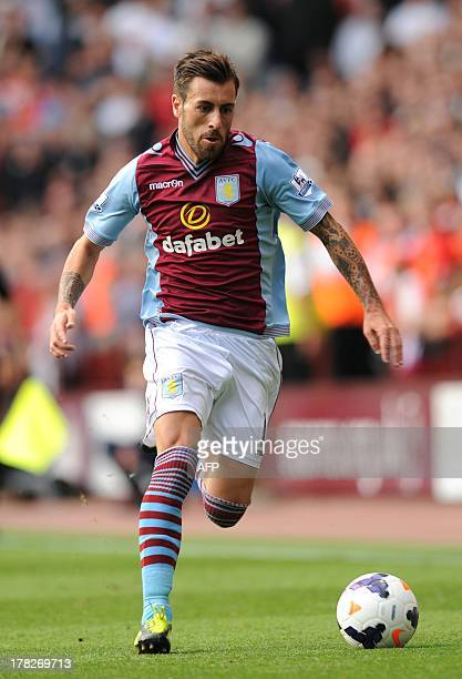 Aston Villa's Spanish defender Antonio Luna runs with the ball during the English Premier League football match between Aston Villa and Liverpool at...