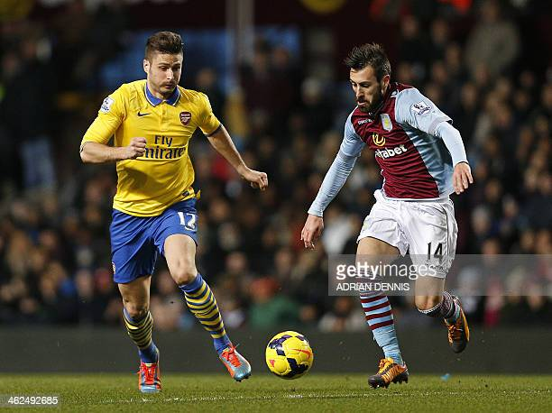 Aston Villa's Spanish defender Antonio Luna vies for the ball against Arsenal's French striker Olivier Giroud during an English Premier League...