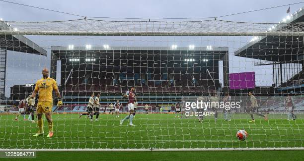Aston Villa's Spanish goalkeeper Pepe Reina reacts after conceding a penalty goal taken by Manchester United's Portuguese midfielder Bruno Fernandes...