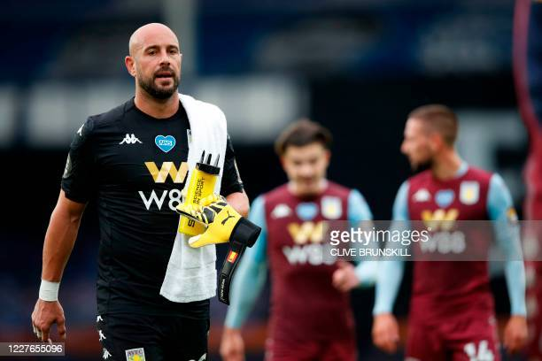 Aston Villa's Spanish goalkeeper Pepe Reina reacts after the final whistle during the English Premier League football match between Everton and Aston...
