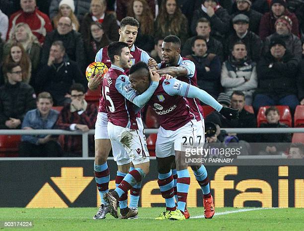 Aston Villa's Spanish striker Adama Traore celebrates with Aston Villa's Spanish midfielder Carles Gil after scoring his team's first goal during the...