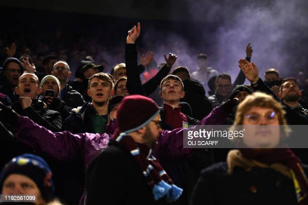 Aston Villa's supporters celebrate a goal during the English League Cup semifinal first leg football match between Leicester City and Aston Villa at...
