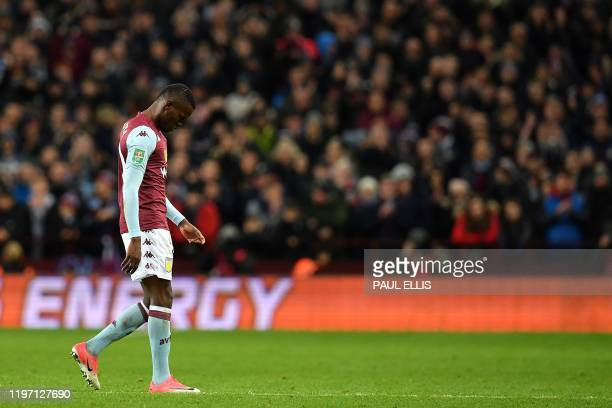 Aston Villa's Tanzanian striker Mbwana Samatta reacts as he leaves the pitch after being substituted off during the English League Cup semifinal...
