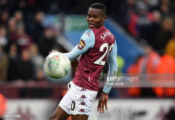 Aston Villa's Tanzanian striker Mbwana Samatta watches the ball go wide of the post after he took a shot at goal during the English League Cup...