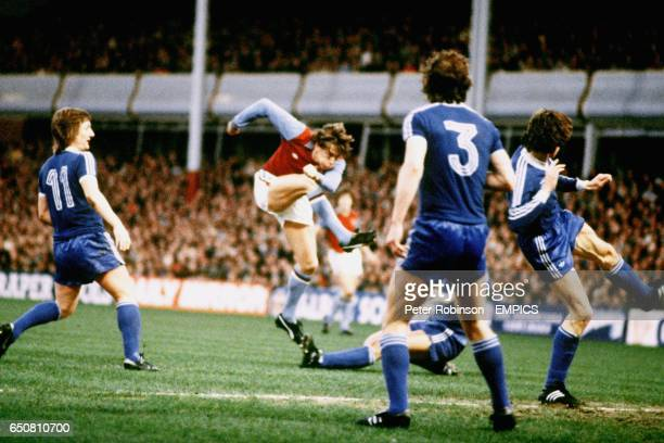Aston Villa's Tony Morley shoots for goal as Ipswich Town's Arnold Muhren tries to block watched by Ipswich Town's Eric Gates and Steve McCall