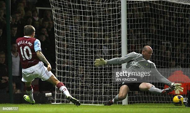 Aston Villa's US Goalkeper Brad Friedel saves a shot by West Ham United's Craig Bellamy during a Premiership football match at Upton Park in London,...