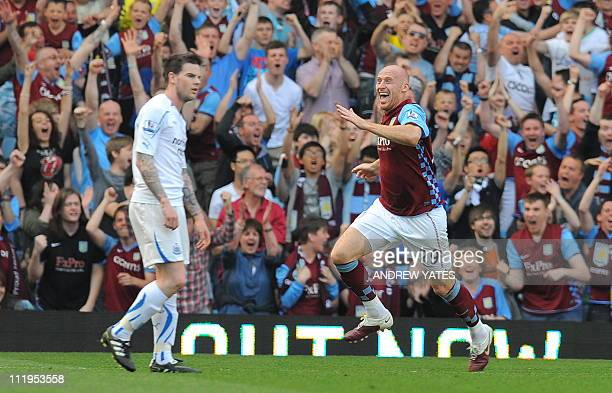 Aston Villa's Welsh defender James Collins celebrates after scoring the opening goal during the English Premier League football match between Aston...