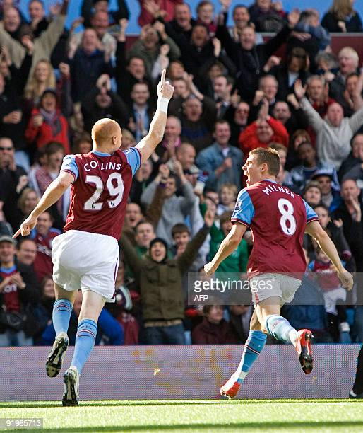 Aston Villa's Welsh defender James Collins celebrates scoring his goal with James Milner during the English Premier League football match between...