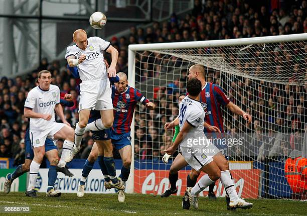 Aston Villa's Welsh defender James Collins head the ball to score a goal during their FA Cup fifth round football match against Crystal Palace at...