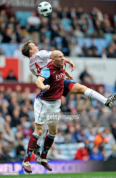 Aston Villa's Welsh defender James Collins vies with Bolton Wanderers' English striker Kevin Davies during the English Premier League football match...