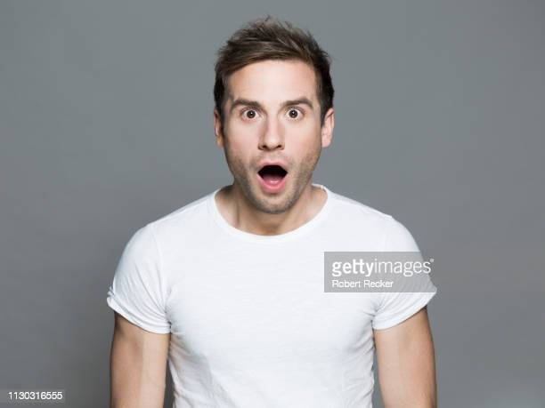 astonished young man - mouth open stock pictures, royalty-free photos & images