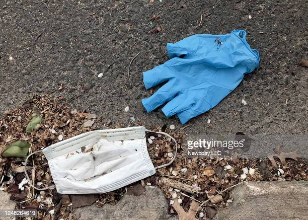 Photo of PPE gloves and surgical masks improperly disposed of on sidewalks and streets in Astoria, New York on April 12 during the coronavirus...