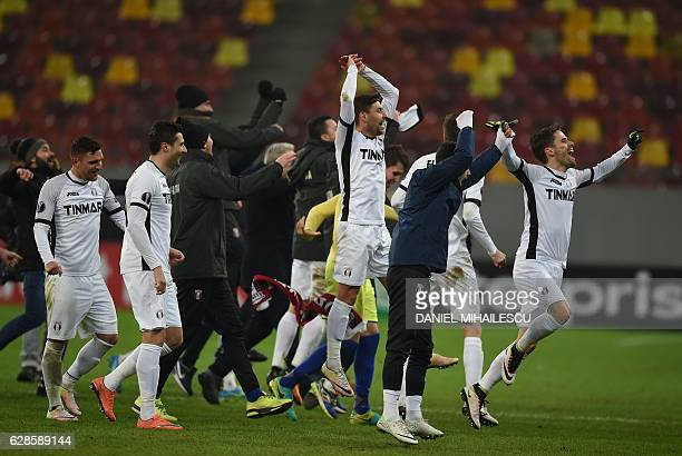 Astra Giurgiu players celebrate after the UEFA Europa League Group E football match between FC Astra Giurgiu and AS Roma in Bucharest on December 8...