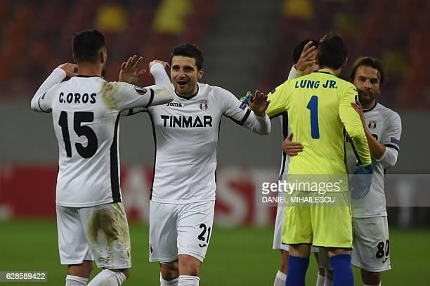 Astra Giurgiu's Cristian Oros celebrates with Astra Giurgiu's Daniel Niculae after the UEFA Europa League Group E football match between FC Astra...