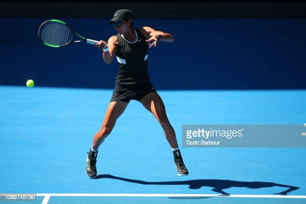 Astra Sharma of Australia plays a forehand in her Mixed Doubles Quarterfinals match with JohnPatrick Smith against Bethanie MattekSmith of the United...