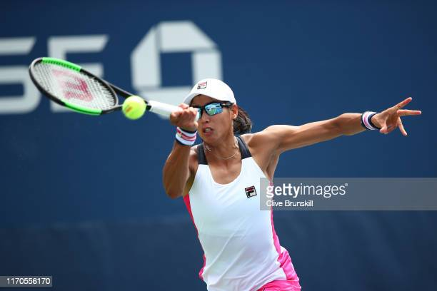 Astra Sharma of Australia returns a shot against Magda Linette of Poland during their Women's Singles first round match on day two of the 2019 US...