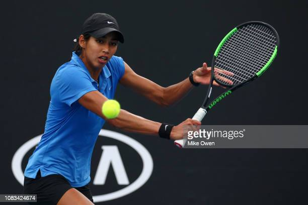 Astra Sharma plays a backhand in her first round doubles match with partner Isabelle Wallace of Australia against Jennifer Brady and Alison Riske of...